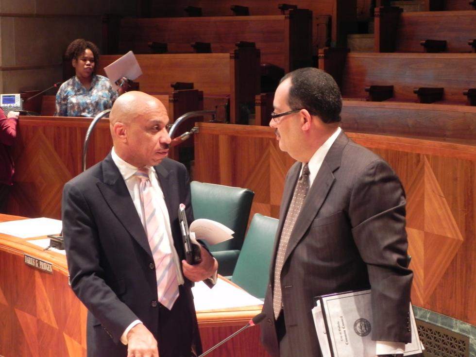 Common Council President Darius Pridgen (D-Ellicott District) speaking with Councilman David Rivera (D-Niagara District).