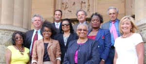 From left to right, front row: Mary Ruth Kapsiak, Bianca Brown (student-elected board member), Dr. Barbara Seals Nevergold, and Patti Pierce; middle row: Larry Quinn, Dr. Theresa Harris-Tig, Sharon Belton-Cottman; back row: Jason McCarthy, James Sampson, and Carl Paladino.