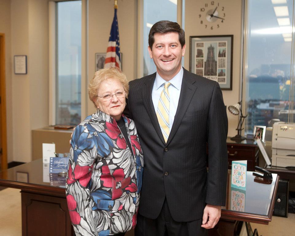 Syposs with Erie County Executive Mark Poloncarz.