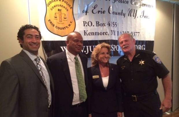 Kathy Weppner with Chumung County Sheriff Chris Moss, the Republican candidate for Lt. Governor; and Erie County Sheriff Timothy Howard; at the Police and Judges Conference of Erie County.