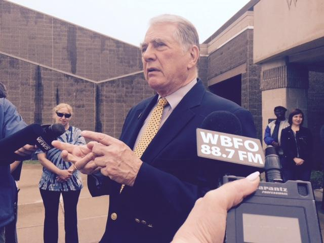 Phil Rumore speaking with reporters outside of a school board meeting.